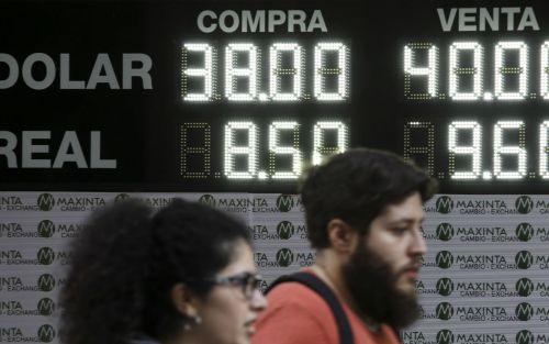 El dólar volvió a caer, perforó los $39 y la tasa subió a 50%